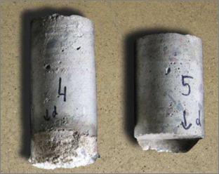Próbki walcowa wycięte z posadzki w celu oceny wytrzymałości na ściskanie, grubości posadzki oraz ilości zbrojenia